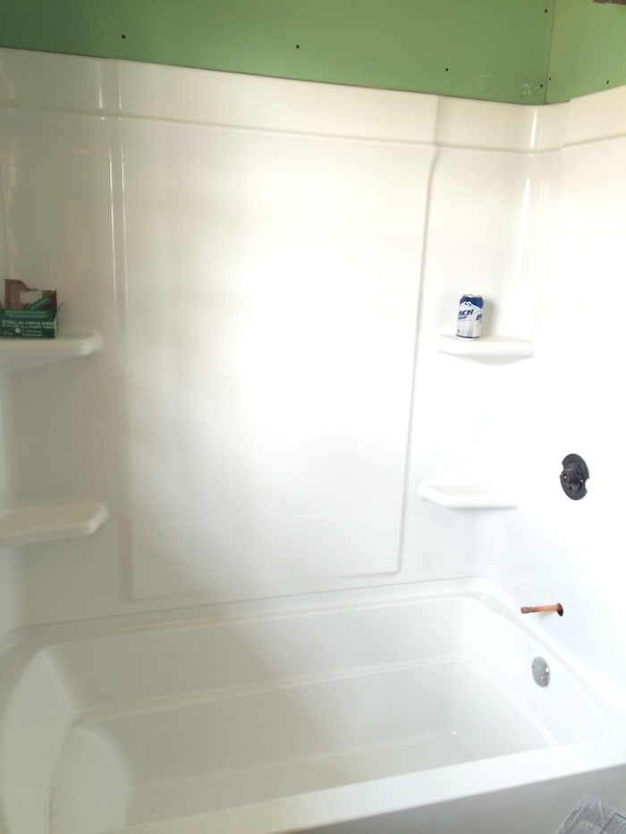 new shower/tub combo in the hall bath of the flip house | theharperhouse.com