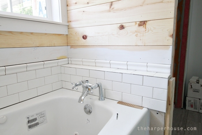 shiplap + subway tile = farmhouse master bath awesomeness! Master Bath progress at the Flip House | theharperhouse.com